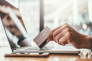 Online banking businessman using Laptop with credit card Shopping online Fintech and Blockchain concept